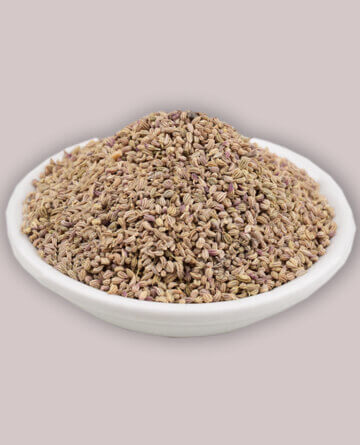 carom seeds in a white bowl