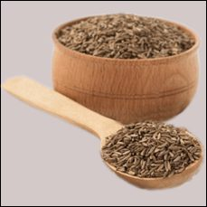 cumin seeds in a wooden bowl and spoon